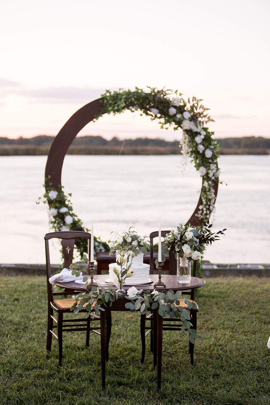 sweetheart table with white and green florals