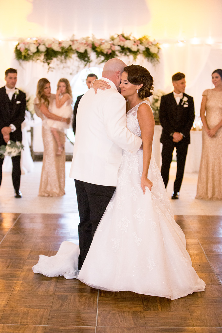 bride and groom share a first dance at their wedding reception on the grounds of Chateau Bu-De