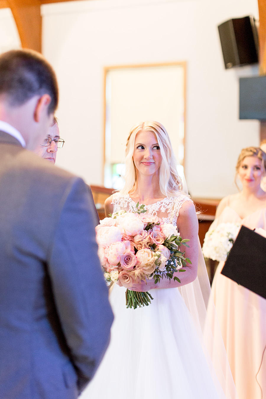 bride standing at the altar