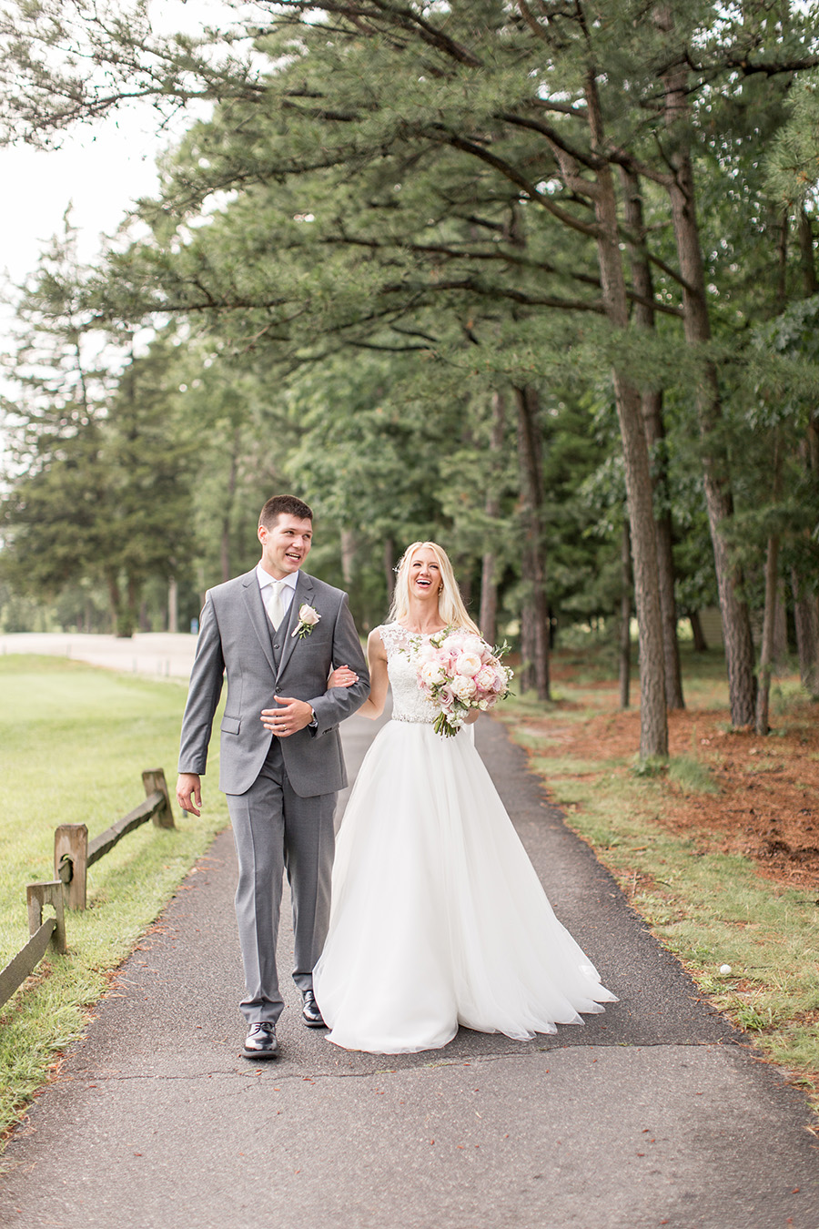 bride and groom walk the grounds at blue heron on their wedding day