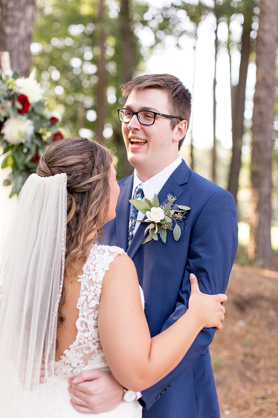 couple laughing together on their wedding day at running deer golf club