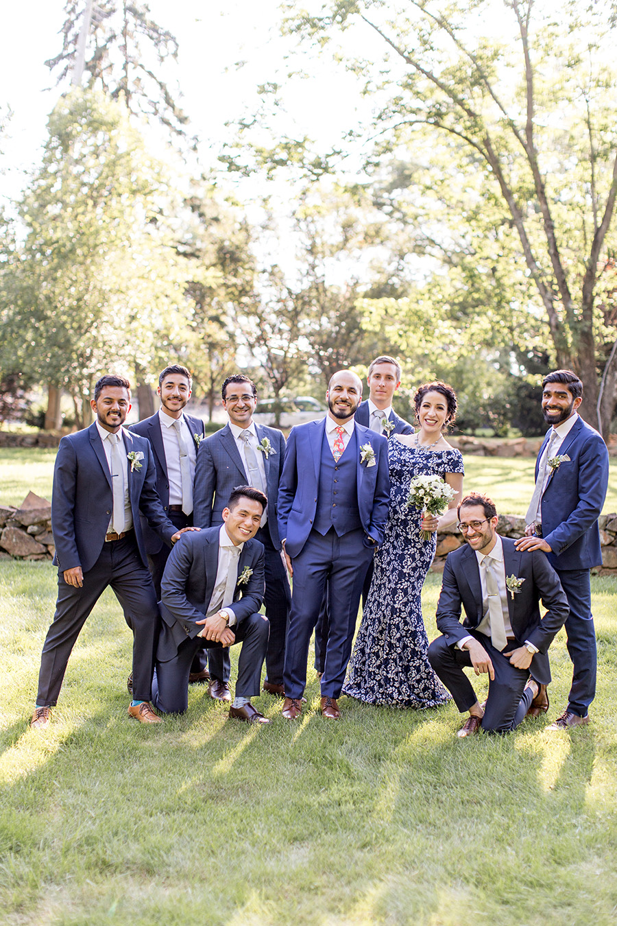crazy groomsmen pose for a picture