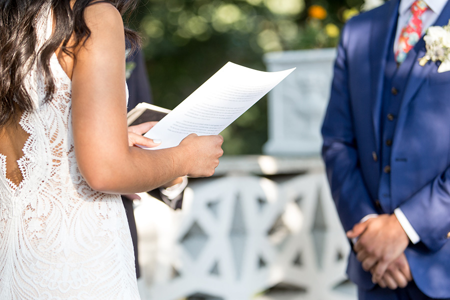 bride reads her vows to her groom