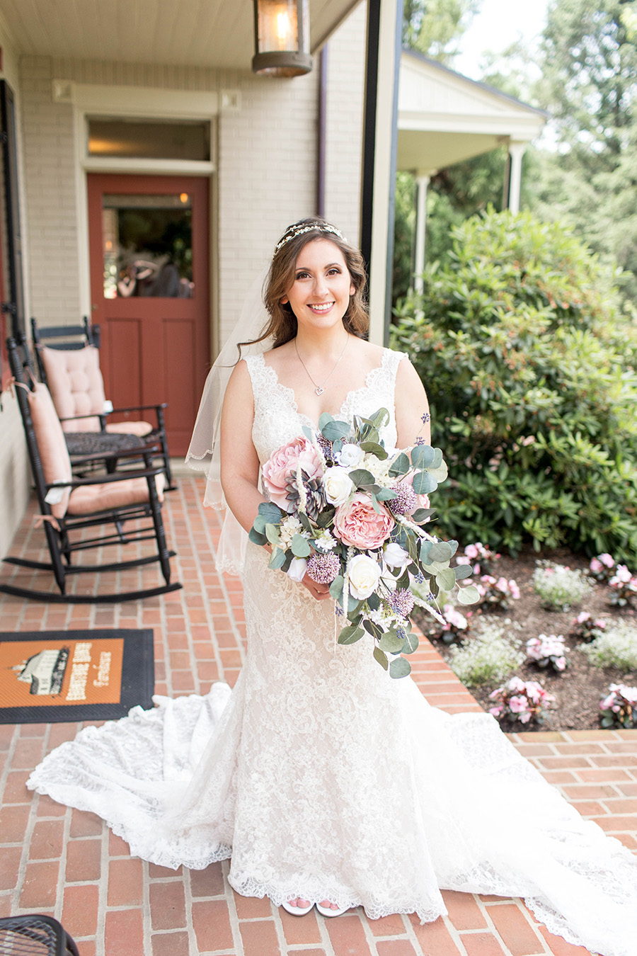 bride outside the farmhouse at ironstone ranch