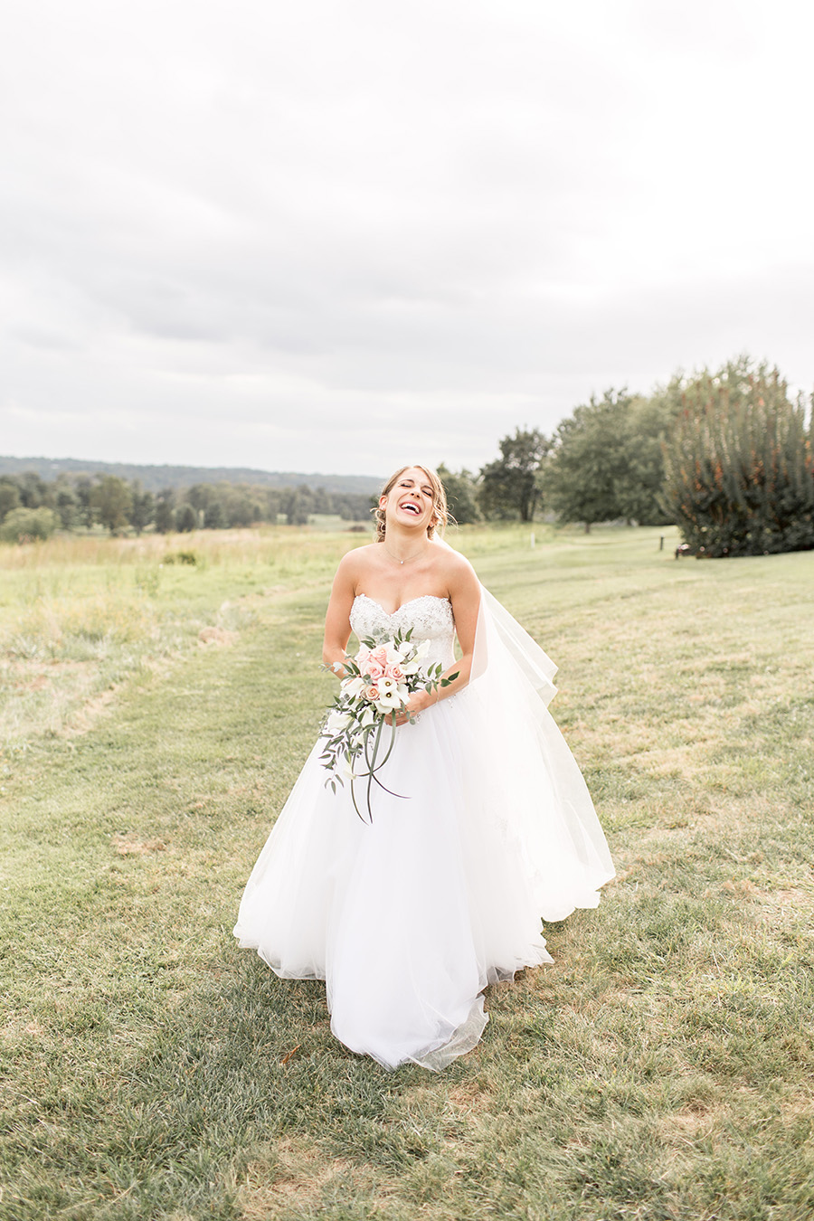 bride laughing on her wedding day