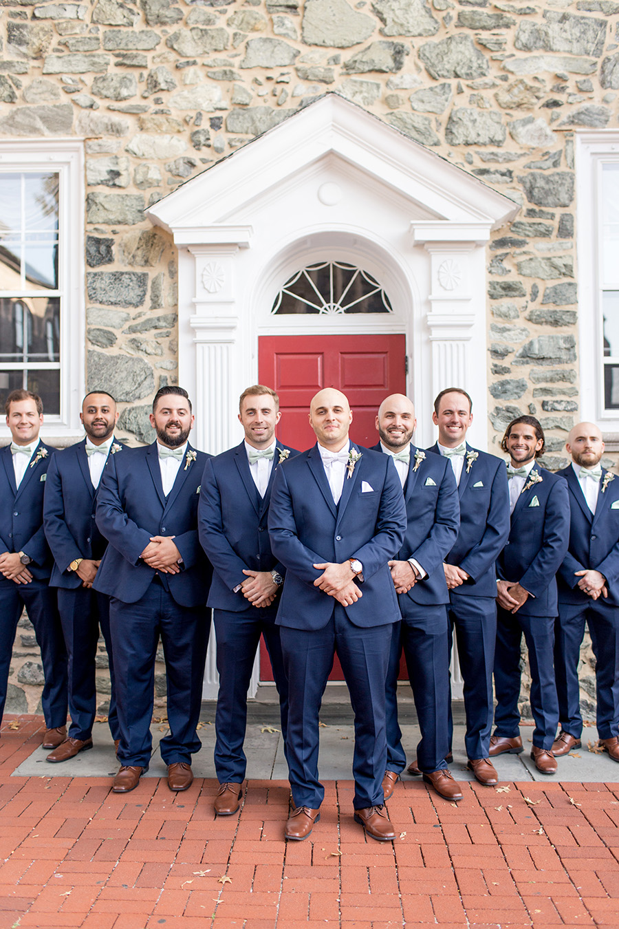 groomsmen dressed in navy for wedding day near penn oaks