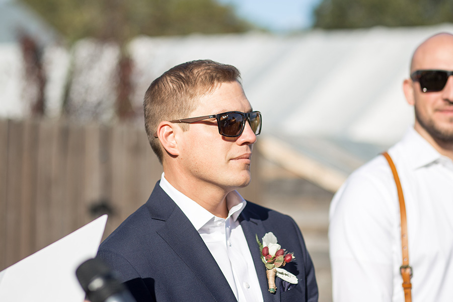 Groom watches bride come down the aisle