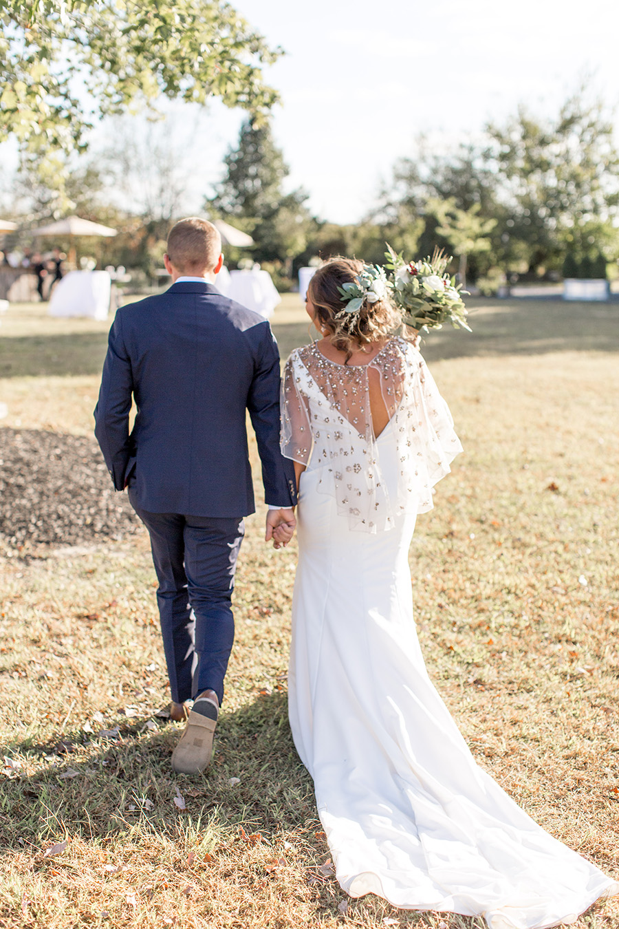 Bride and groom walk together after wedding ceremony