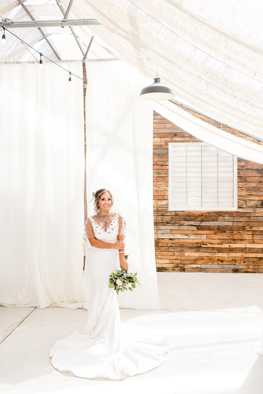 Modern wedding dress with embellished capelet