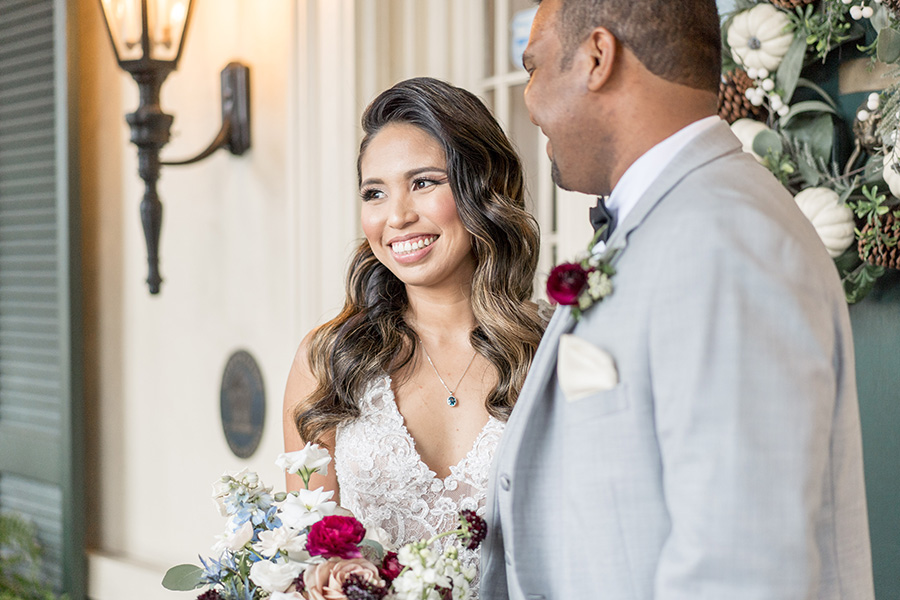 Bride smiles with her groom