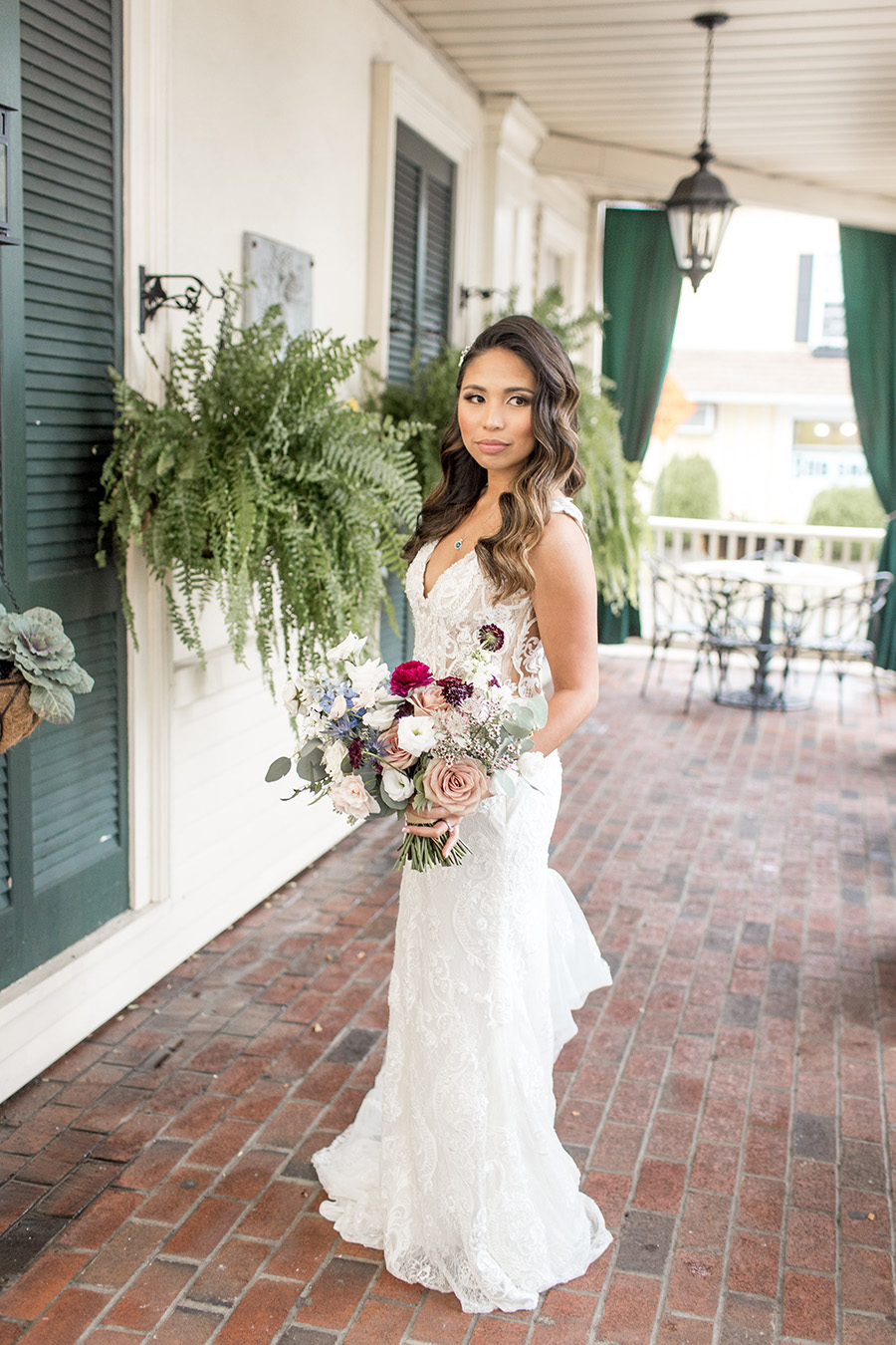 Bride in lace wedding gown with hollywood waves