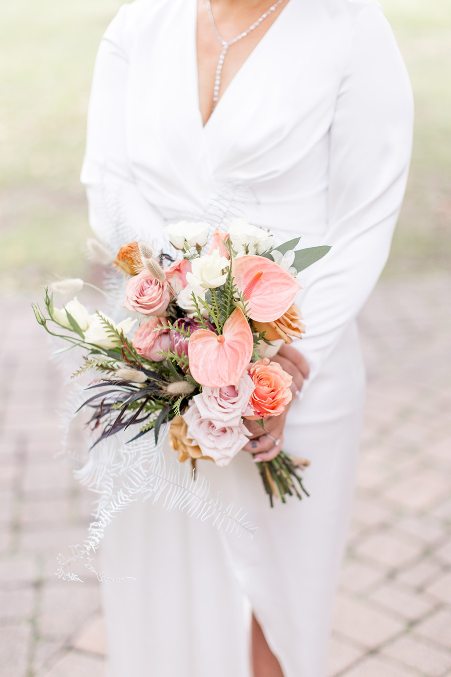 Fall wedding bouquet with protea and calla lilies