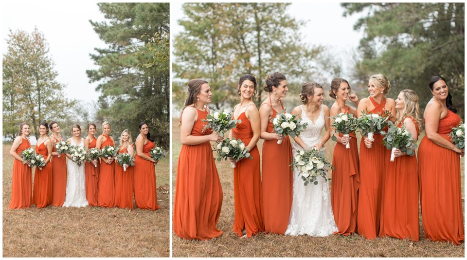 Bridesmaids in burnt orange floor-length dresses with the bride at Eagle Manor