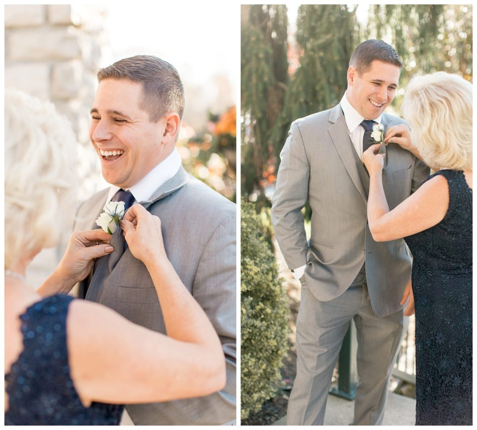 Mother of the groom helping him with his boutonnière