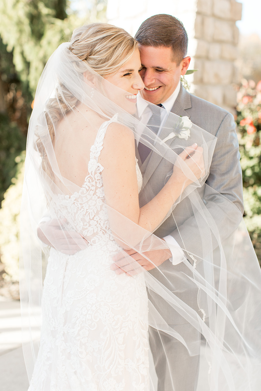bride in lace open-backed gown and messy braid