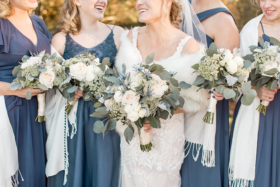 winter blue and cream wedding bouquets at Scotland Run
