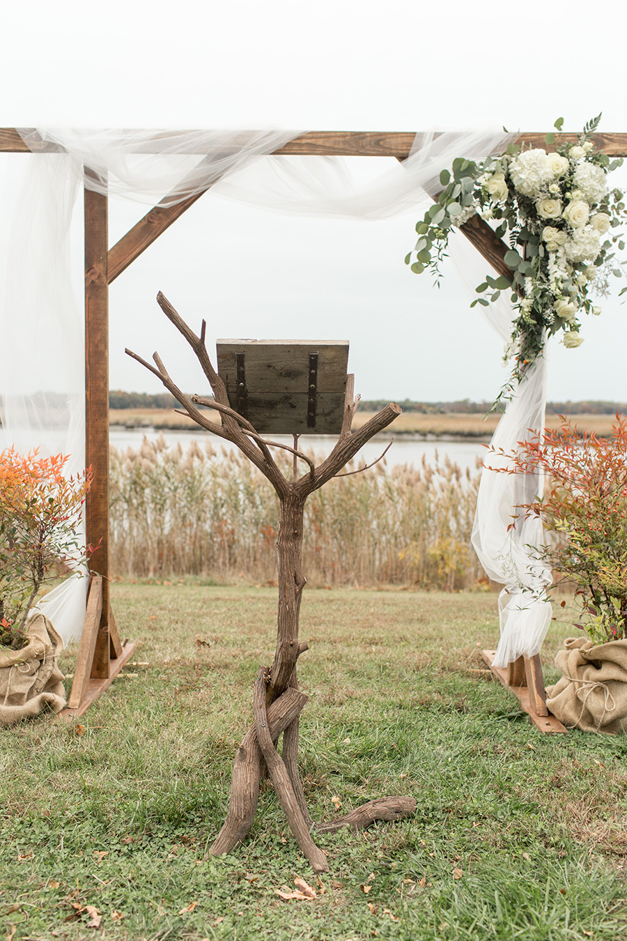 rustic outdoor waterfront wedding ceremony