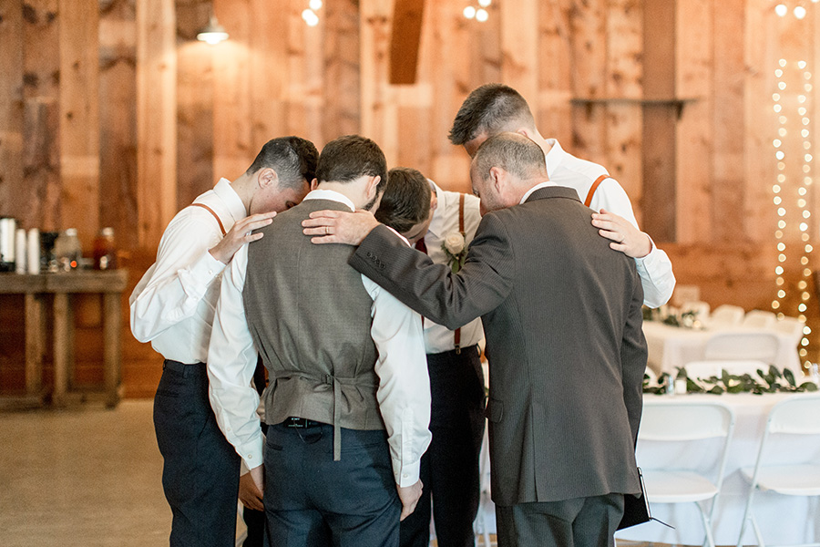 pre-wedding ceremony prayer in the barn at Turkey Trac farms