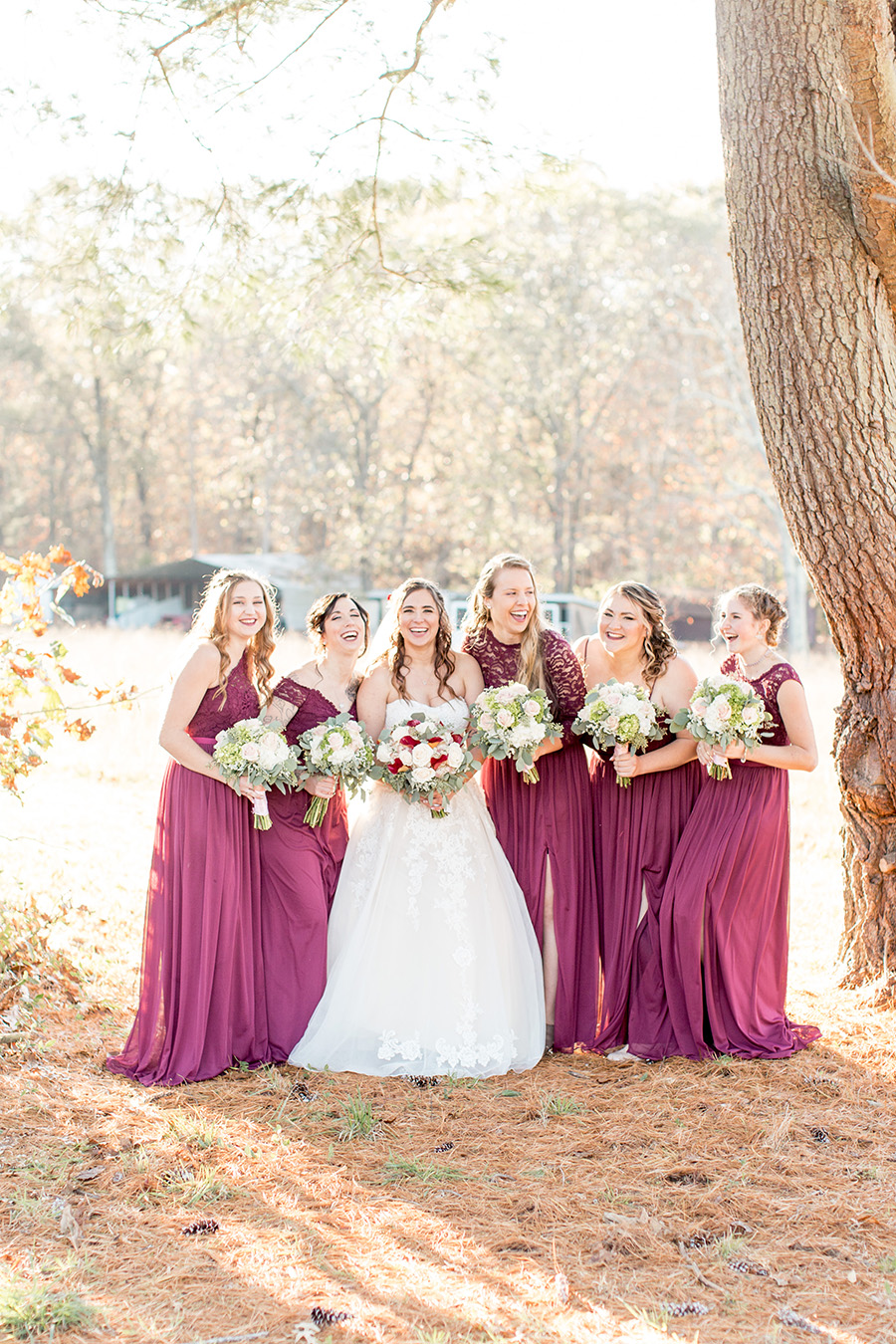 bridesmaids in floor length plum dresses