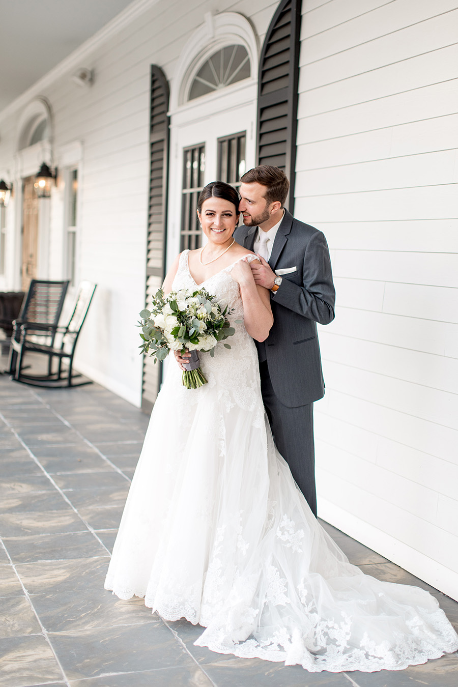 Southern style porch outside the carriage house is perfect for wedding portraits