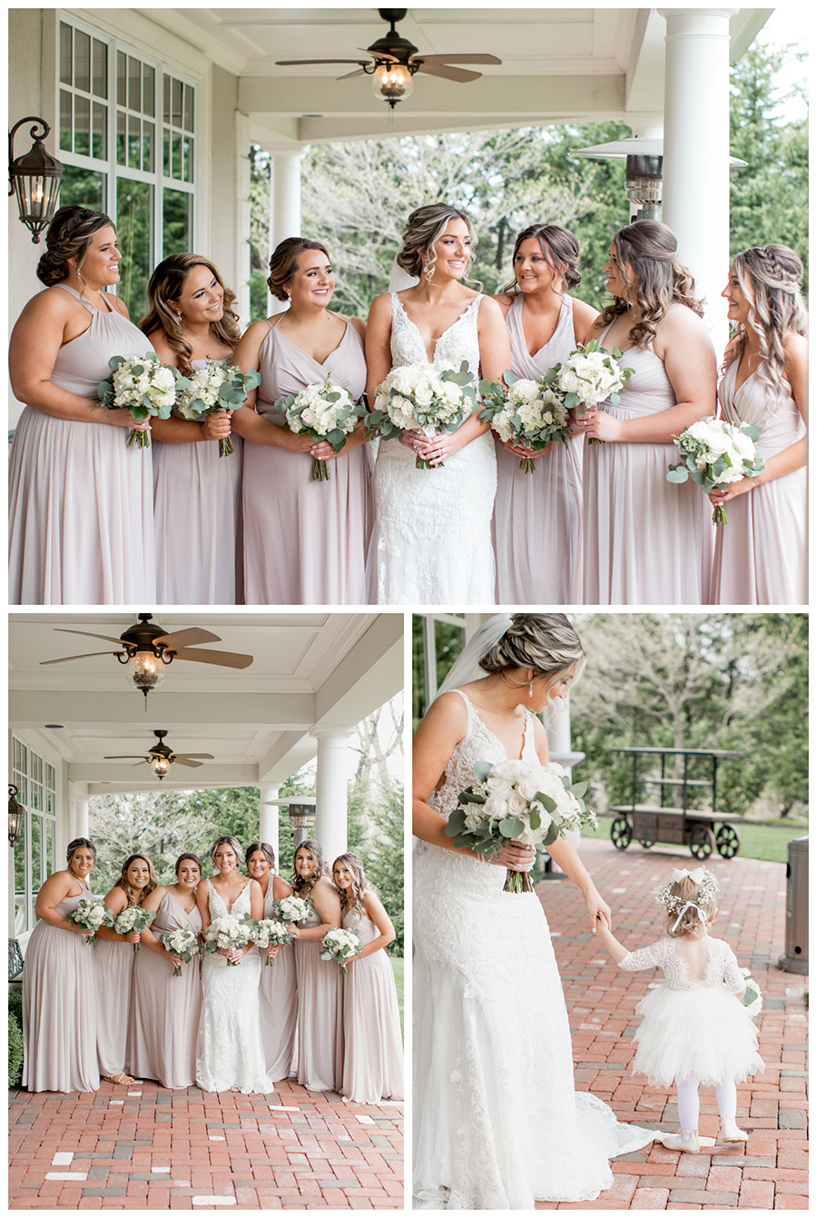 bride and her bridesmaids in floor length, neutral biscotti colored bridesmaid dresses and white flowers