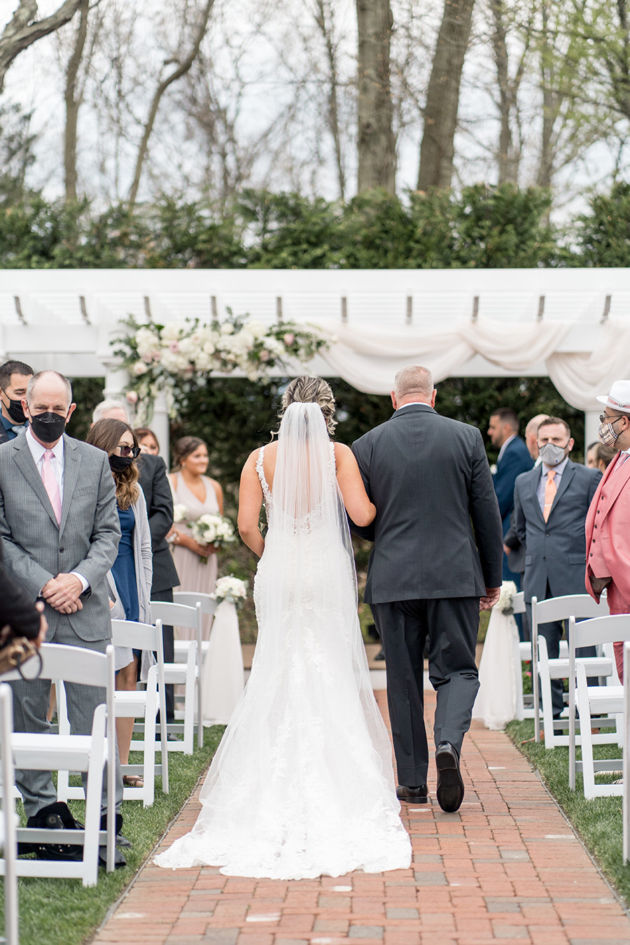 bride walking up the aisle at their outdoor wedding ceremony at the Bradford Estate