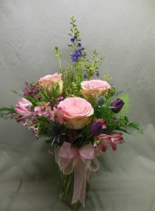picture of bouquet with pink, blue and purple flowers.