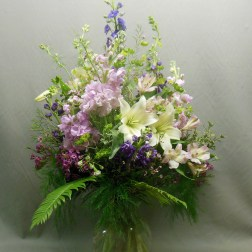 picture of a bouquet with purple, pink, cream white flowers