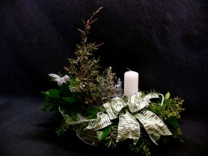 picture of christmas center piece with handcrafted metal wire trees as well as nice candle and silver bird.