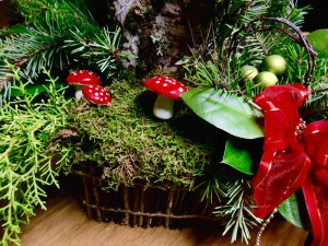 picture of red mushroom scene in Christmas center piece.