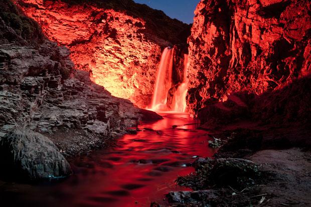 Colorful Long Exposure Photos of Glow Sticks Dropped Into Waterfalls glowwaterfall 7
