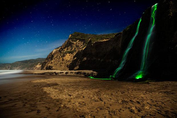 Colorful Long Exposure Photos of Glow Sticks Dropped Into Waterfalls glowwaterfall 8