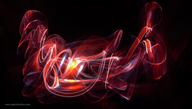 Beautiful Abstract Light Paintings Created With Lighted Swords in Pitch Darkness lpkata3