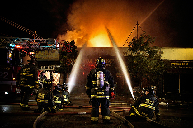 Interview with Andrew Nelles, Former Chicago Sun Times Photographer Chicago Firefighters respond to a multi structure two alarm fire on the 1100 block of West Argyle Street in Chicago Ill. on Wednesday August 6 2008. The fire which destroyed four businesses start
