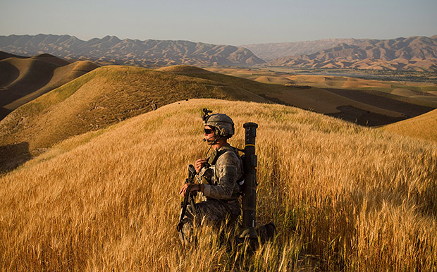 Interview with Andrew Nelles, Former Chicago Sun Times Photographer U.S. Army 1Lt. Steven Robinson from 2nd Platoon Bravo Battery 2nd Battalion 321st Field Artillery Regiment 82nd Airborne Division pauses during an early morning foot patrol of hills around Outpo