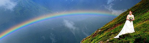 Wedding Photo of a Bride on the Side of a Mountain... With a Double Rainbow rainbow
