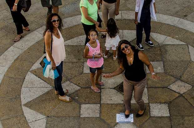 Using a Smile Sign On the Ground to Get Passersby to Pose for the Camera smile10