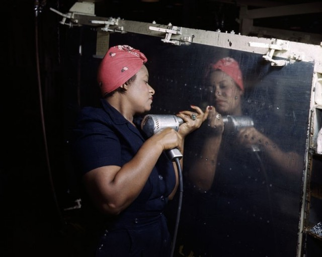 """A """"Rosie"""" working on a A-31 Vengeance bomber, Nashville, TN 1943."""