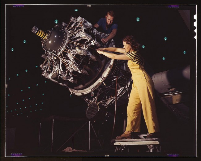 A woman is trained to work on an engine installation at the Douglas Aircraft Company, 1942.