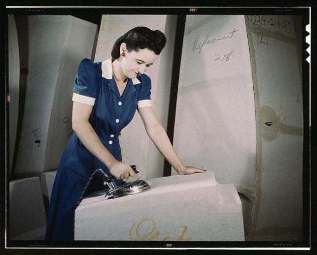 A woman working on self-sealing gas tanks at Goodyear Tire and Rubber Co. in Ohio, 1941.