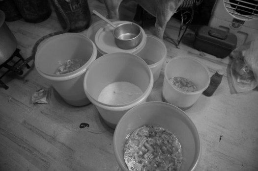 Chicken soup and rice pudding are set in different containers and let to be cool down.