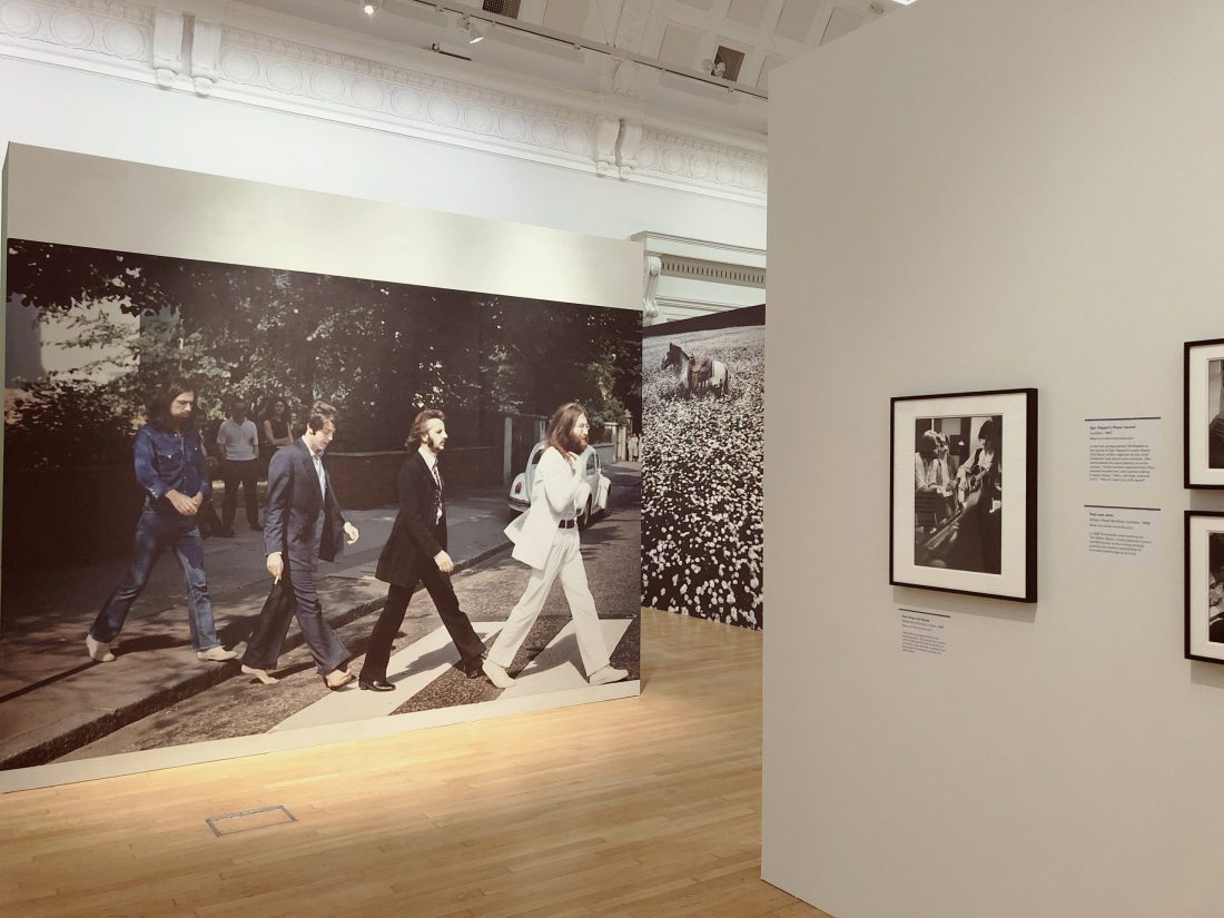 Photos of the Beatles hanging in a museum