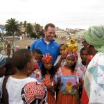 Peter Liptak shares books with Namibian schools at the end of a 250km desert race