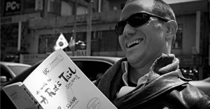 Peter Liptak on the streets of Itaewon reading A Rat's Tail