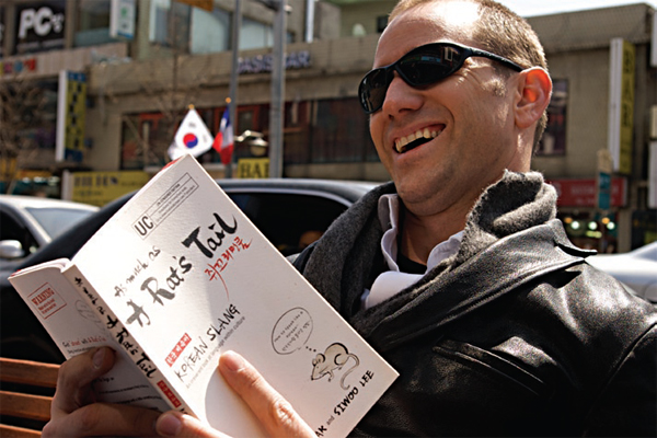 """Peter Liptak in Itaewon reading """"As much as a Rat's Tail"""""""