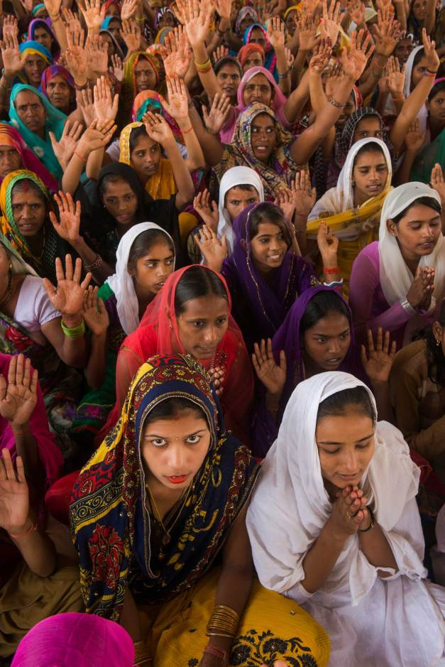 A religious gathering is held in Uttar Pradesh, India. Photograph by conservation photographer and cultural photographer Pete Oxford.