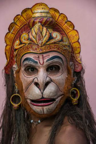 A native man shows off a Hanuman mask made for the traditional Raas Festival. Photograph by conservation photographer and cultural photographer Pete Oxford.
