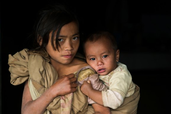 Konyak Naga children pose for the camera. Photo by indigenous people photographer Pete Oxford.