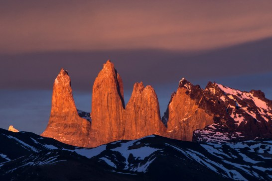 Torres del Paine is illuminated by early morning sun. Photograph by landscape photographer and conservation photographer Pete Oxford.