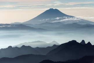 Sumaco Volcano is in the distance with many valleys and mountains before it. Photo by aerial photographer Pete Oxford.
